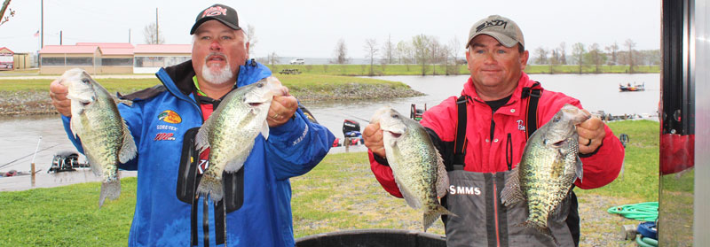 Tony Hughes, left, and Jeff Riddle with two D'Arbonne slabs that propelled them to the ACT National Championship.