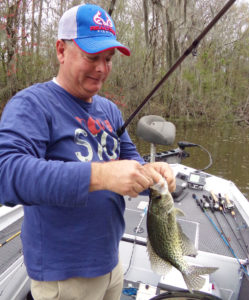 McCarty, who enjoys catching sac-a-lait and bream as much or more as he does bass, talks about an area in the Union Oilfield in the Stephensville area as he fishes in mid-February.