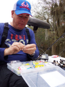 Bill McCarty said he reties as often as possible when sac-a-lait fishing because he uses 6-pound test line. He has a plastic tray full of artificials and terminal tackle at the ready to do just that.