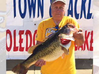 John Gillard shows off the 10.98-pound bass he caught on April 27 during the Toledo Bend Oilman's Classic. The lunker bit a blueberry Texas-rigged Zoom lizard in 2 feet of water in the San Miguel area, and won Gillard Big Bass honors for the tourney. (Photo courtesy of the Toledo Bend Lake Association)