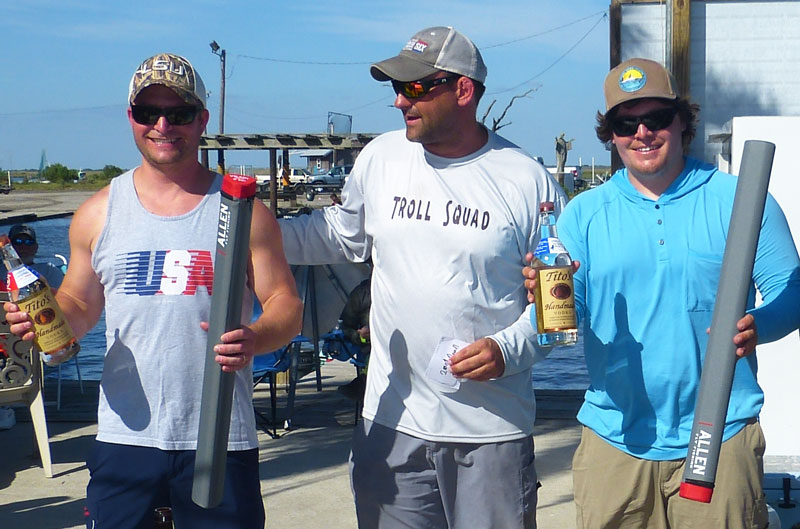 Mathew Roberts (center) of Mission Six, congratulates Overall Division winners Jessie Hamilton (left) and Ty Hibbs (right) at April's 3rd annual Fly Fishin the Mission tournament.