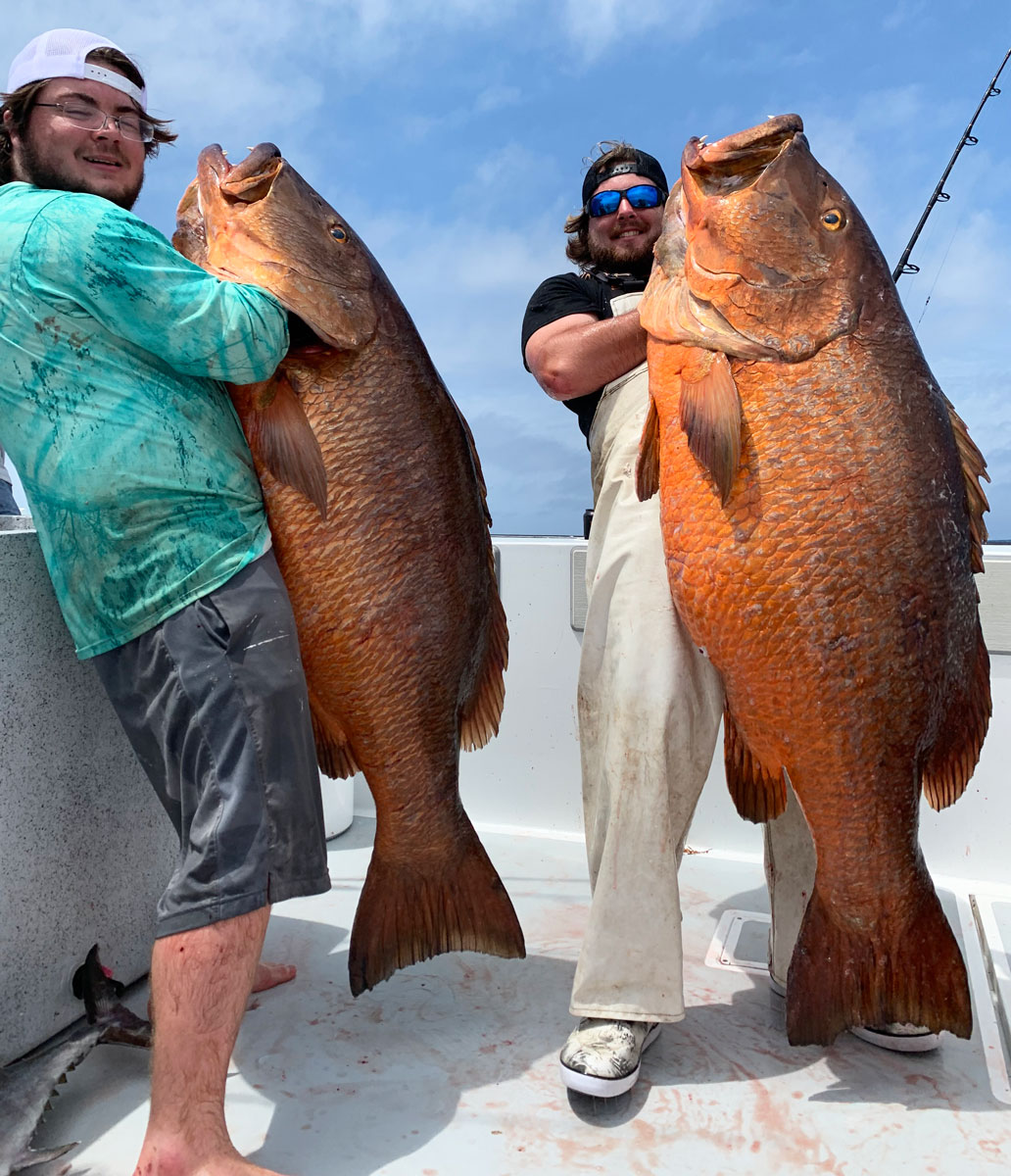 Baton Rouge brothers Alex Maciasz, left, and charter skipper Joey Maciasz hold the two cubera snapper destined to place in the Louisiana Top 10 Fish Records List. The cubera at left weighed 85 pounds and was caught by Luke Hodges. The one at right is holding weighed 100.5 pounds and came after a near 30-minute battle by Jeff Thompson to get it in the boat in mid-May.