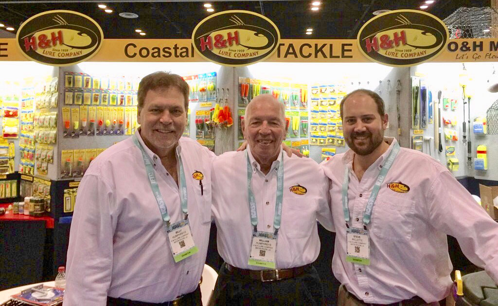 From left, Billy Humphreys Jr., H&H Lure Co. vice president and in charge of national sales, Bill Humphreys Sr., H&H Lure Co. founder, and Steve Miclette Jr., H&H Lure Co. director of operations, are shown at the 2017 ICAST at the Orange County Convention Center in Orlando, Fla. On July 10-12, H&H Lure Co., started in June 1959, returns to the ICAST to proudly unveil its 60th anniversary logo.