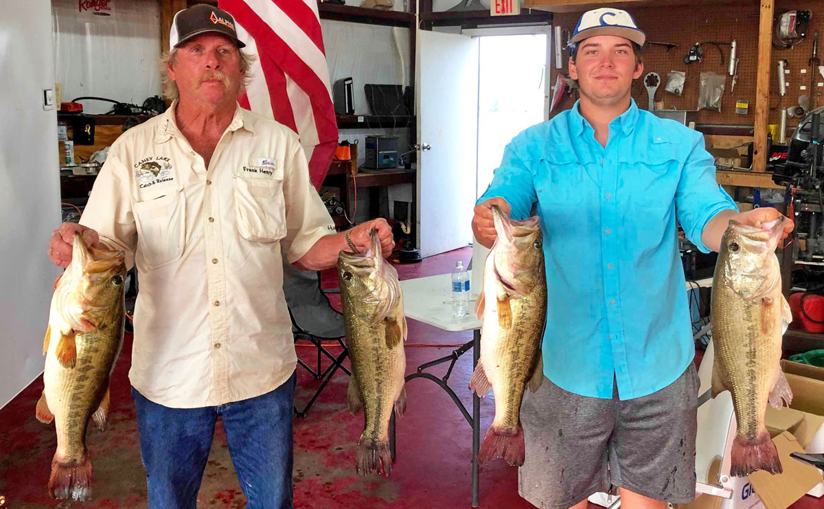 Daniel Taylor, right, and Frank Henry with two of their biggest bass in the big stringer division.