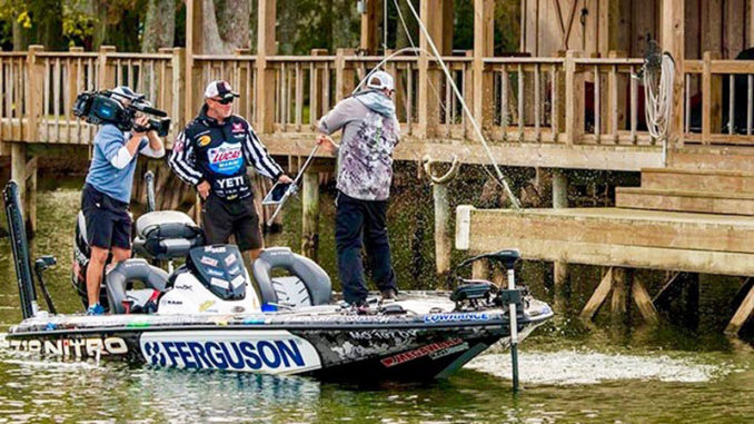 An angler lands a keeper in the MLF World Championship on Lake St. John, held earlier this year to be broadcast on TV beginning this weekend.