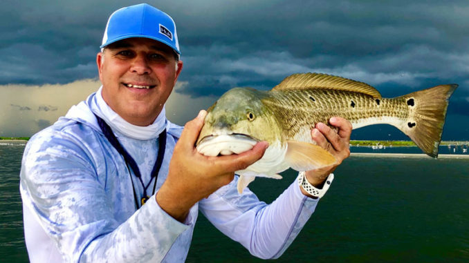 Capt. Davey Miles with Cajun Fishing Adventures shows off a nice redfish just minutes before a bad storm forced him to leave Breton Island last Friday. The good news is the Mississippi River has finally fallen to more normal late-summer levels, which should mean solid fishing this fall downriver.