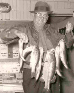 Harry Hawthorne with a Bussey bass in this vintage 1960's photo.