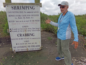 A sign at the Big Dam lists the rules and regulations for cast netting and crabbing.