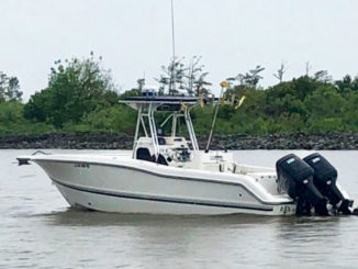 Boats like this one near Pilottown have been running aground on newly formed sandbars that were created when the Mississippi River reached near record-breaking highs earlier this spring and summer. As the river drops, anglers are urged to use caution because of sediment and obstacles deposited during the high-water conditions. (Photo by Sea Tow Westbank)