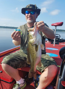 Brian Merrideth of Missouri holds a 6½-pound bass he caught on a Top Toad plastic frog in the summer while fishing lily pads with John Dean at Toledo Bend.