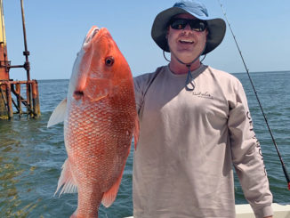 Tripp Staples with nice snapper he caught fishing out of Cypremort Point.