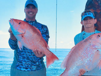 Shannon Prokasy and Mitchell Prokasy, 14, with red snapper. Mitchell's snapper weighed 22 pounds.