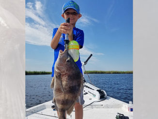 David Herard, 7, shows off the West Division's winning sheepshead, which tipped the certified scales at Hackberry Fishing Camp and Marina at 5.75 pounds. For his catch, Herard is set to receive a $1,500 Academy Sports & Outdoor gift card at the CCA awards banquet on Oct. 17 in Baton Rouge. (Photo courtesy of CCA Louisiana)