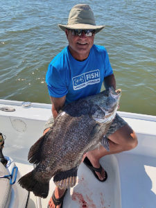 "Tom Kallam of Huntsville, Ala., displays his monster tripletail weighing 35 pounds taken Sept. 4, fishing with Capt. Louis ""Rok"" Rossignol of Venice Guide Service."