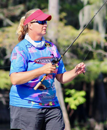 Alisa Johnson gets ready to pitch her Senko to a Caddo Lake bass.