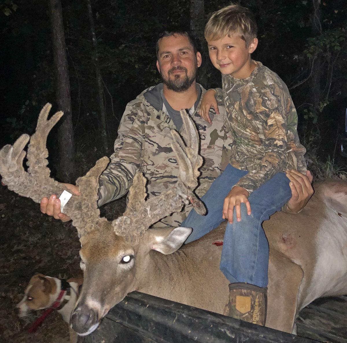 Derek Goss and son, Tucker, with Derek's impressive 169-inch Jackson Parish velvet buck.