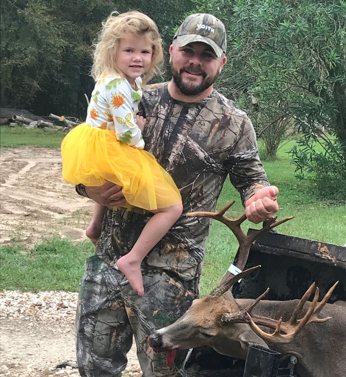Jeremy Cooley and his daughter with his 13-point Beauregard Parish buck.