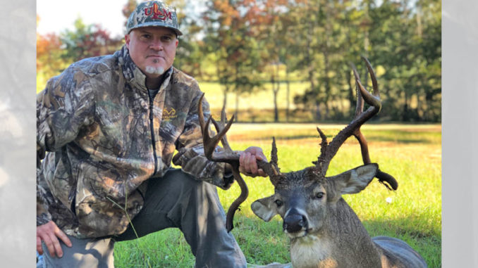 Wade Gibson poses with his 14-point, double drop tine Union Parish buck.