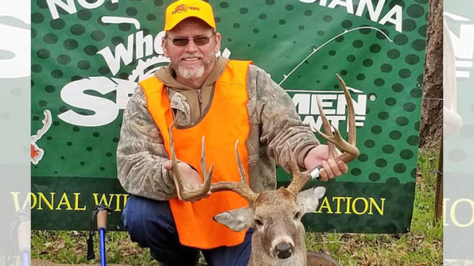 Craig Long and the 161-inch buck he got Dec. 8 on a handicapped hunt in Natchitoches Parish.