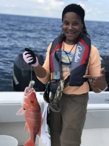 A workshop participant with her catch during an offshore trip at the summer weekend workshop.