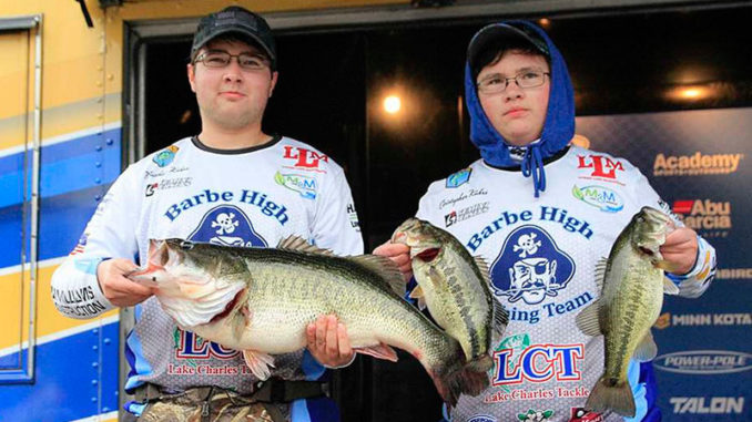 Matthew Kahrs (left) displays his 10.9-pound Toledo Bend lunker, while his brother, Christopher, holds up two other bass taken Jan. 26 during the 2020 Mossy Oak Fishing Bassmaster High School Series event at Toledo Bend. The brothers placed second in the tournament with three bass weighing 15.6 pounds. (Photo courtesy of Ronnie Moore/B.A.S.S)