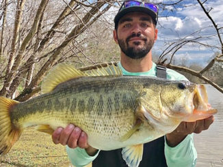 "This 8.17-pound bass bit on a chartreuse/blue crank bait on Feb. 15 in Lake Fausse Pointe. Joseph Martin of Baton Rouge set the hook and landed the ""hawg"" with the help of his fishing buddy, Austin Whitaker of Baton Rouge. The bass, which was released after being weighed and photographed, was his personal best.(Photo courtesy of Joseph Martin)"