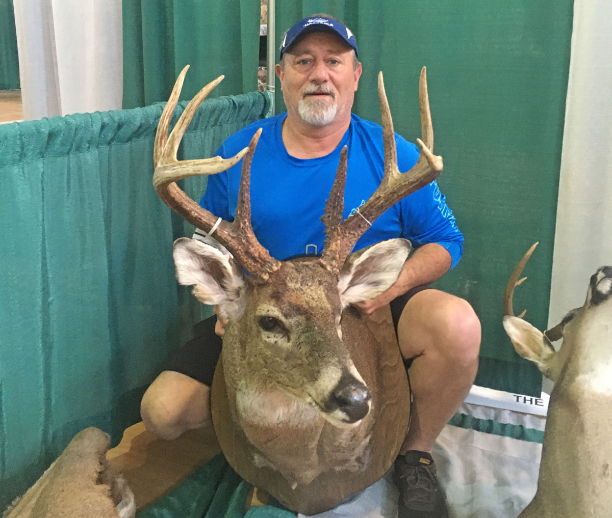 Vincent Chauvin Jr. of Bogalusa and his state-record crossbow buck killed on the Tensas River National Wildlife Refuge.