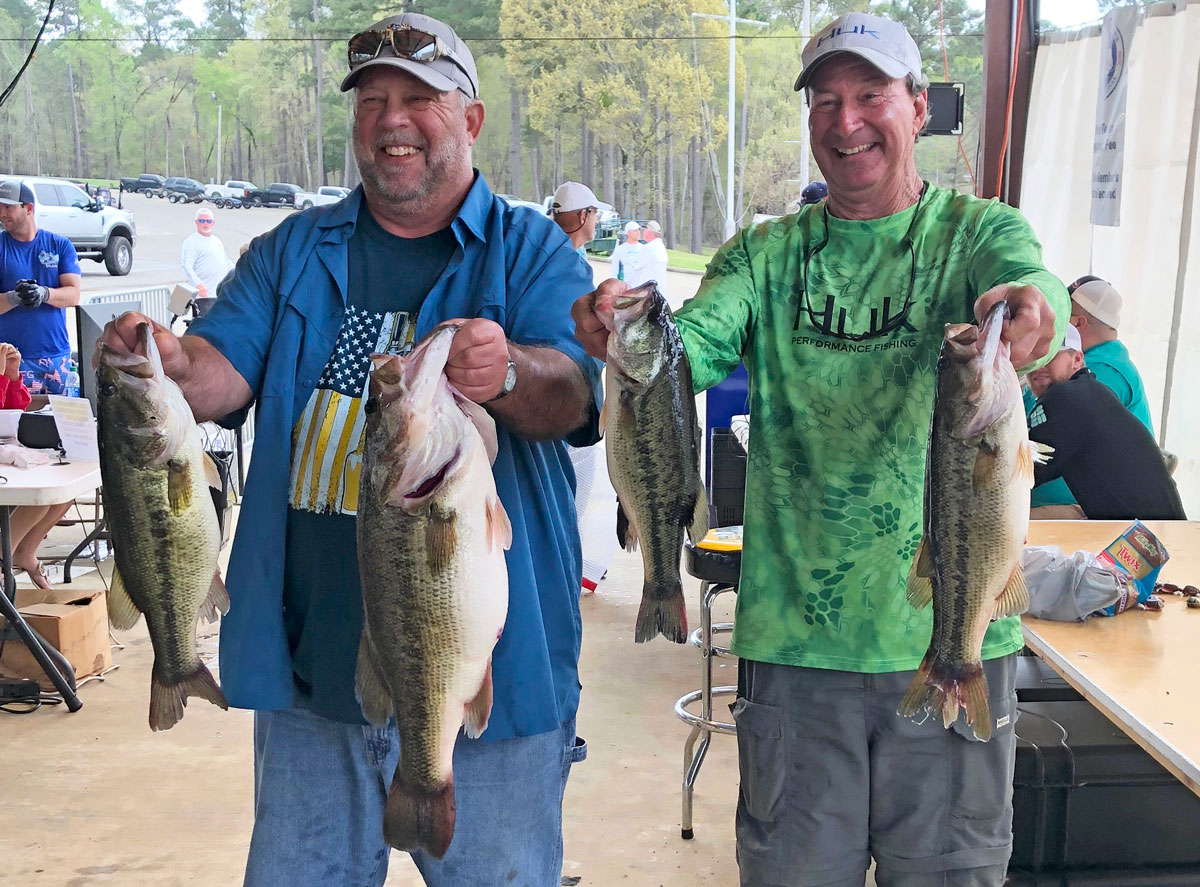 Paul Resweber, left, holds a 10.07-pound bass in his left hand after weighing in a limit on March 14, the second day of the Texas Oilman's Bass Invitational at Toledo Bend. Resweber, who lives in St. Martinville, and Mike O'Brien of New Iberia, finished third that day with 22.18 pounds and 25th overall with 33.24 pounds. (Photo courtesy Sherrie Resweber)