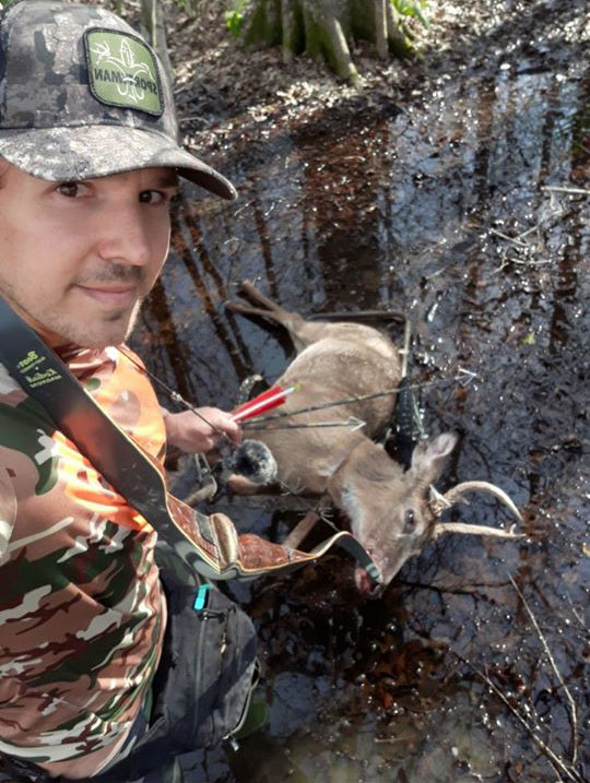 A buck carted out 2 miles using the ball bungees around its neck and legs to keep the deer from falling off.