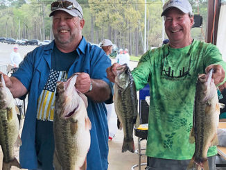 Paul Resweber, left, holds a 10.07-pound bass in his left hand after weighing in a limit on March 15, the second day of the Texas Oilman's Bass Invitational at Toledo Bend. Resweber, who lives in St. Martinville, and Mike O'Brien of New Iberia, finished third that day with 22.18 pounds and 25th overall with 33.24 pounds. (Photo courtesy Sherrie Resweber)