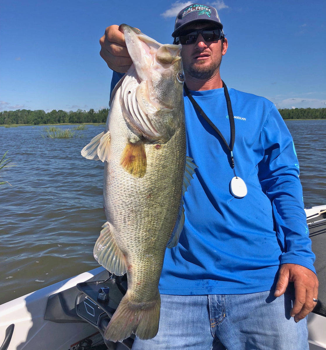 Branch's Travis Meche Sr. holds up an 8.82-pound bass he caught May 2 in Sandy Cove at Lake Fausse Pointe. The 'hawg' bit on a crawfish-colored Strike King jig with a crawfish-colored Speed Craw around midday that Saturday. (Photo courtesy Travis Meche Sr.)