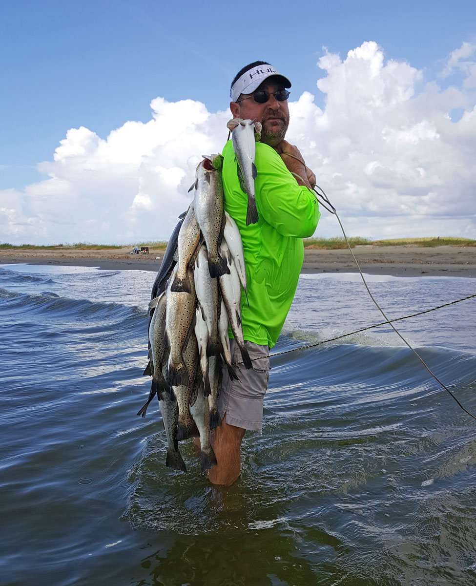 Playing a speckled trout in crashing surf can be a test for both an angler and his tackle.
