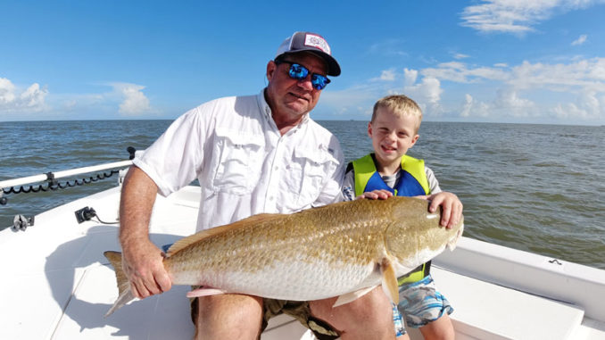 Seven-year-old Carter Barnett fished with his peepaw, Charlie Barnett, in Venice getting on the bull reds.