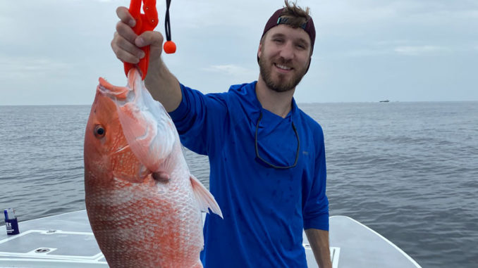 Daniel Kopsco with a red snapper caught out of Port Fourchon on July 4.