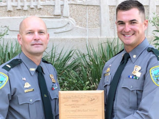 Lt. Lane Kincaid presents the 2020 Mississippi Flyway Council Award to Corporal Michael Hebert.