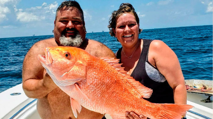 Chuk Cole and Jessica Spooner with Jessica's 22.4-pound snapper caught out of Venice on July 18, 2020.