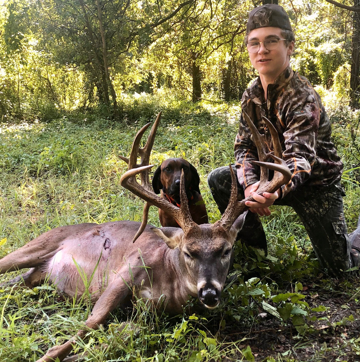 Gray Worthey with his 14-point Hogue Island buck that scored 170.