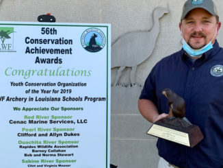LDWF's Chad Moore, who oversees the Archery in Louisiana Schools program, with the 2019 Youth Conservation Organization award.