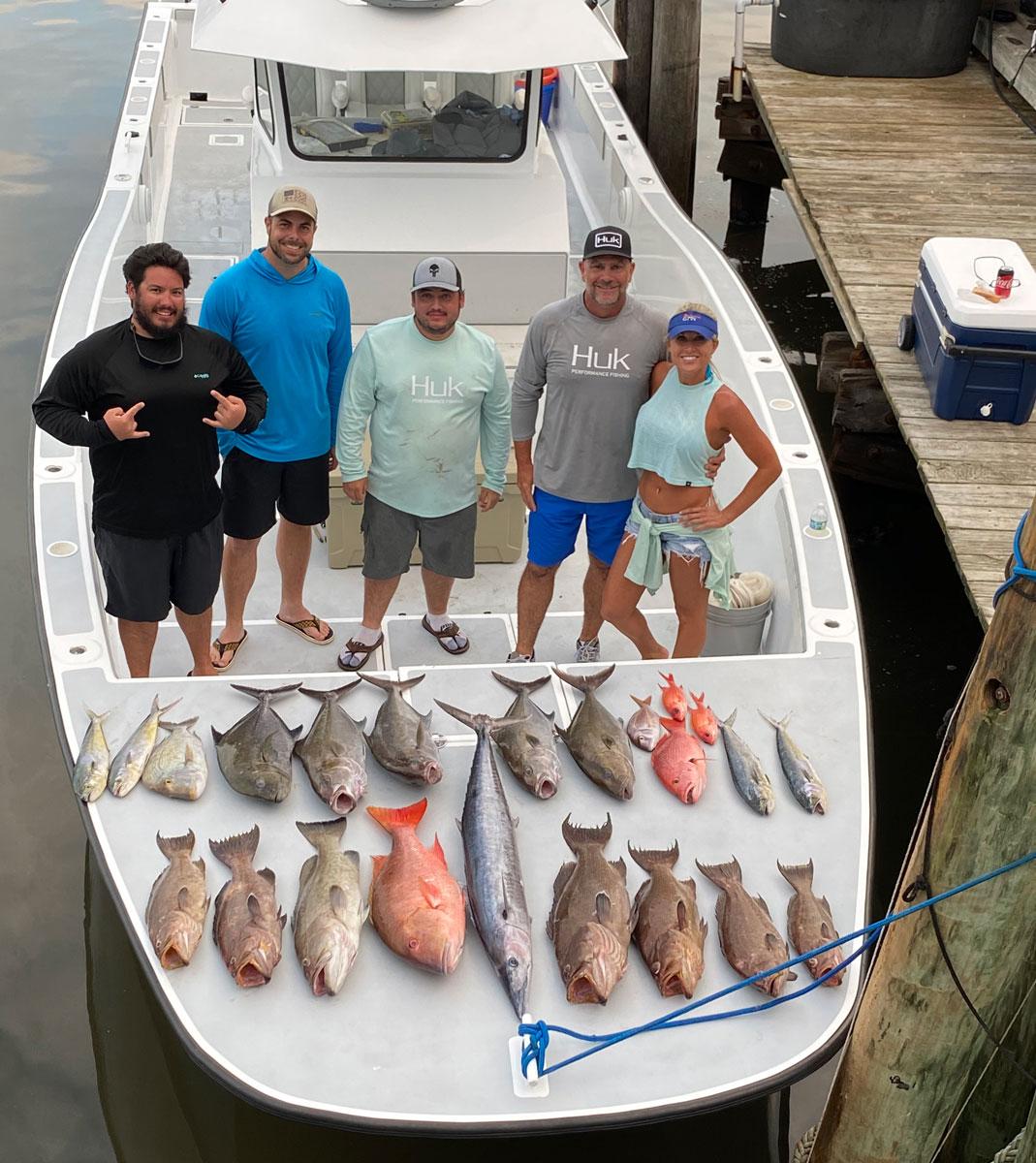 Daniel Rainbolt, Josh Sparks, Micha Rainbolt, Chris Williams and Lisa Schlitzkus after their September trip with Down the Bayou Charters.