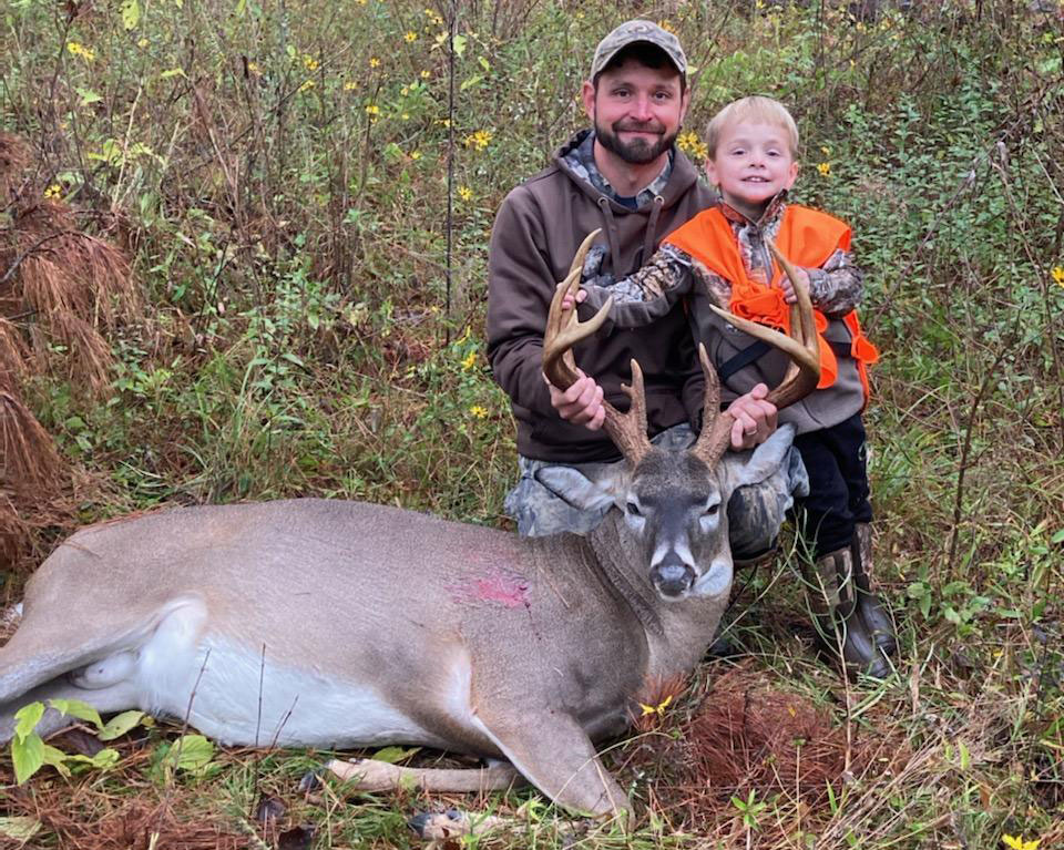 Lance Kelpe and his son with the big buck he killed at the Hooks and Horns hunting club in Jackson Parish.
