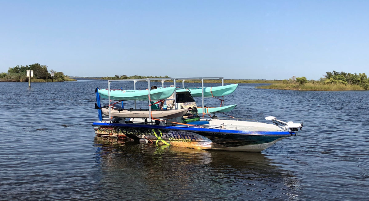 """This """"mothership"""" carries up to six kayakers on an overnight redfish trip."""