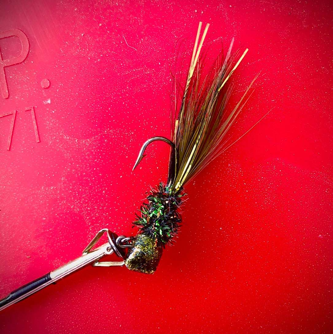 This is the gold head, green hand-tied Jimmy Watt hair jig that enticed the 3.60 pounder into biting.