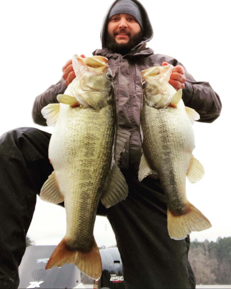 "Cavalier shows his two big bass from Feb. 12, an 11.9-pound whopper and ""the little one,"" a 5.8 pounder. He released both back into the lake."