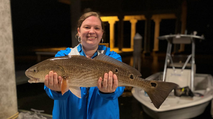 Participant shows off her catch after learning new skills at 2020 Women's Fishing Workshop