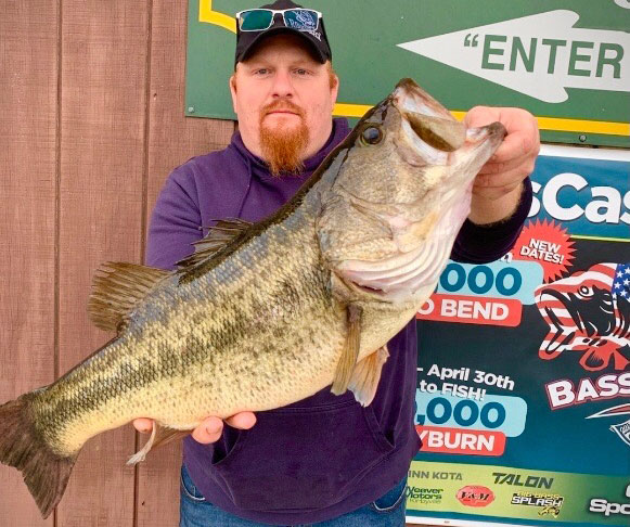 """Lloyd """"Hoss"""" Fowler with his 10.05-pound """"Hoss"""" bass caught on a wacky worm."""