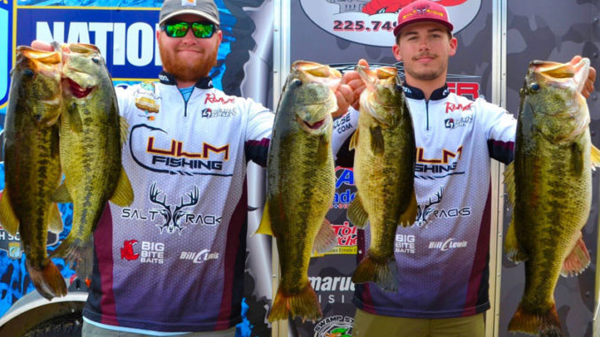 Jacob Andrews, left, and Connor Nimrod show off their outstanding catch, including the big bass of the event, a Caney Lake 11 pounder.