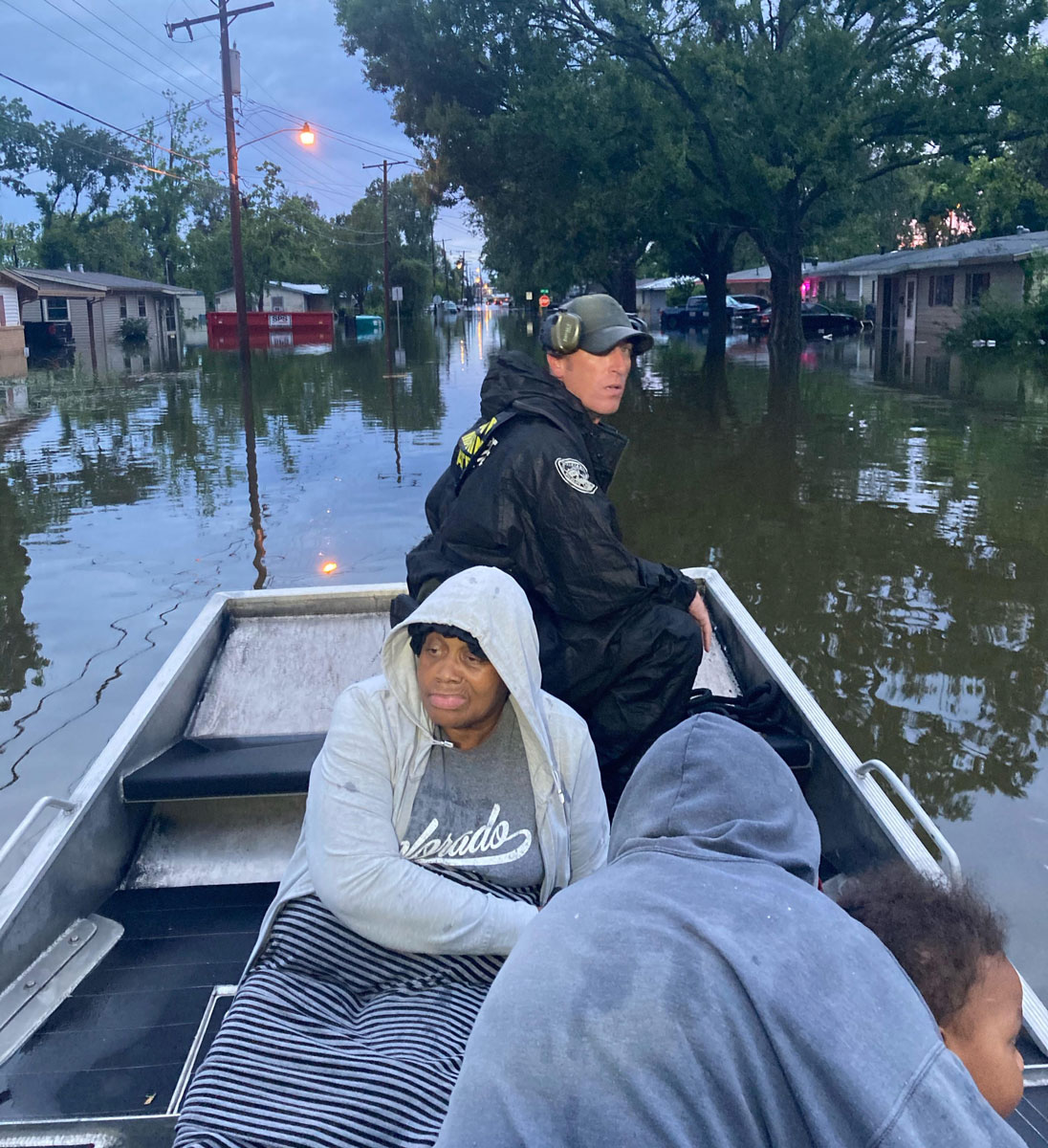 Lt. Beau Robertson is on the bow of a vessel with people on board they helped evacuate from flooded waters in southeast Lake Charles. (Photo courtesy LDWF)