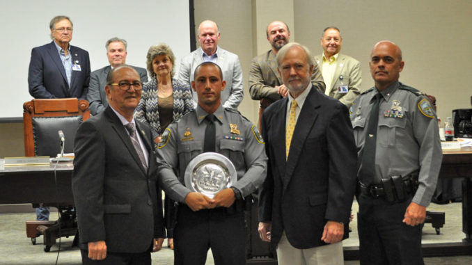 LDWF Secretary Jack Montoucet with Corporal James Bruce, the Shikar-Safari Club Representative, and Col. Chad Hebert with Louisiana Wildlife and Fisheries Commission representatives in the back.