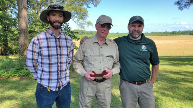 Ed Justice (center) accepts the Lower Mississippi Valley Joint Venture's 2020 Private Landowner Conservation Champion Award, joined by his son John Justice (left), and John Hanks (right), Louisiana Dept. of Wildlife & Fisheries Biologist Supervisor.