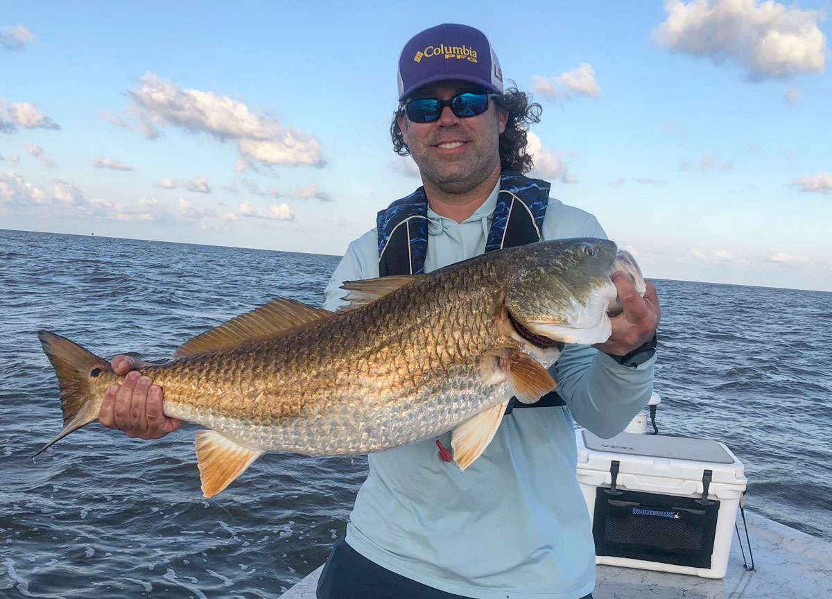 Brian Jaynes showing off just how large some of these bull reds are that cruise along the Sabine jetties. They provide a heck of a fight for some great entertainment.